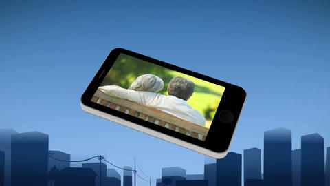 Smartphone showing a senior couple relaxing Animation