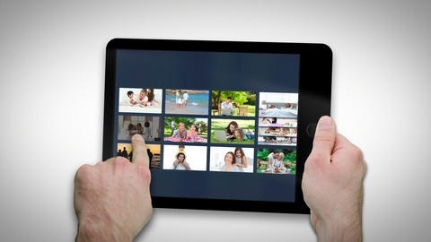 Tablet computer showing families relaxing Stock Video Footage