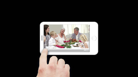 Smartphone showing families during Christmas Animation