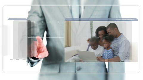 Businessman dragging videos about families using a Footage