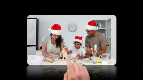 Hand scrolling through and activating christmas vi Stock Video Footage