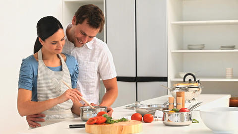 Couple preparing sauce for lunch Footage