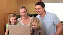 Family sitting in front of a laptop Stock Video Footage