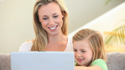 Mother and daughter using a laptop Footage
