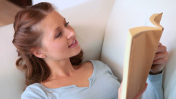 Young woman reading a book Stock Video Footage