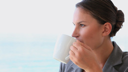 Woman drinking a hot coffee Footage