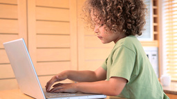 Boy typing on a laptop Footage