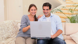 Happy couple with a laptop Stock Video Footage