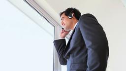 Standing man speaking in headset Footage