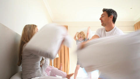 Young family having a pillow fight Footage