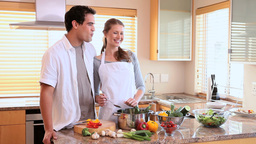 Woman feeding her husband a tomato Stock Video Footage