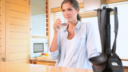 Woman drinking a glass of water Footage