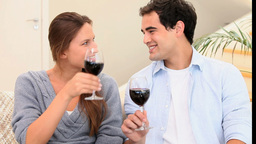 Couple toasting with glasses of wine Footage