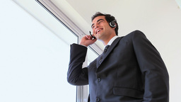 Businessman holding his headset microphone Footage