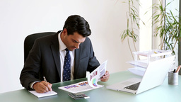 Businessman working on documents Stock Video Footage