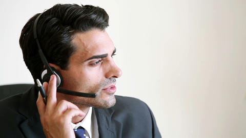 Call centre agent talking with a client Footage