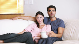 Cute couple watching the television Footage