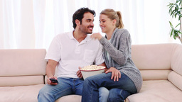 Couple watching a movie on the television Footage