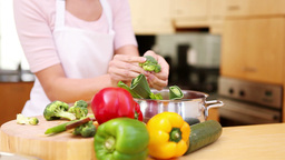 Young Woman Preparing A Meal stock footage