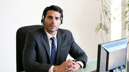 Call centre agent using a headset Stock Video Footage
