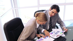 Business people are looking at charts Stock Video Footage