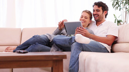 Young couple holding a tablet computer Footage