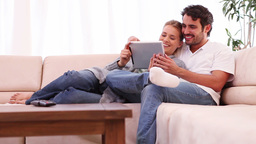 Young couple holding a tablet computer Stock Video Footage