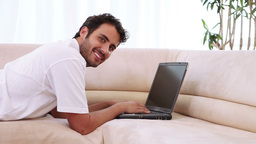 Young man typing on his laptop Stock Video Footage