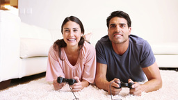 A young couple playing video games Footage