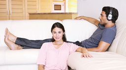 Woman relaxing while her boyfriend is listening to Stock Video Footage