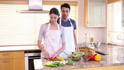 Happy couple cooking together Footage
