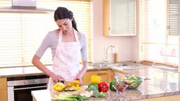 Smiling Woman Preparing A Meal stock footage