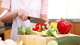 Young woman preparing a meal with vegetables Stock Video Footage