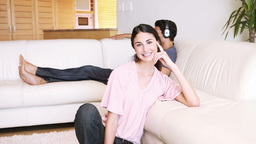 Young woman sitting down Footage