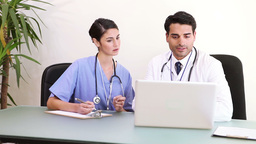 Doctors working with a laptop Stock Video Footage