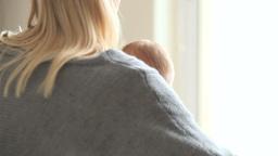 Woman picks up a babynand kisses his cheek Footage