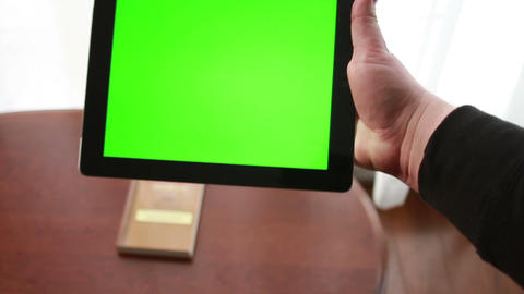 Book or Tablet? Tablet with Green Screen Live Action