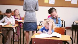 Peaceful teacher handing out sheets Stock Video Footage
