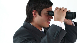 Smiling businessman looking through binoculars Footage
