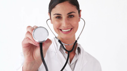 Smiling doctor showing her stethoscope Footage
