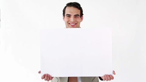 Businessman holding a blank poster Stock Video Footage