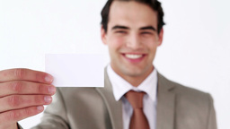 Smiling man holding a business card Footage