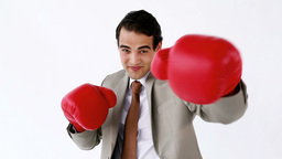 Smiling businessman using boxing gloves Stock Video Footage