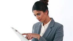 Happy businesswoman reading a newspaper Footage