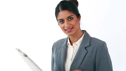 Happy businesswoman reading a newspaper Stock Video Footage