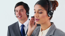 Smiling call centre agents working together Footage