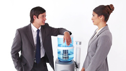 Business people talking next to the water cooler Footage