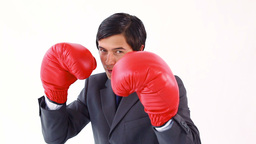 Happy executive using boxing gloves Footage