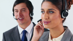 Smiling business people using headsets Stock Video Footage