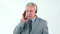 Smiling mature man using a headset Stock Video Footage